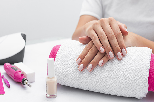 front-view-woman-getting-her-manicure-done-salon